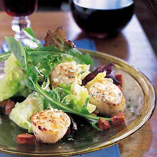 Sauteed Scallops with Andouille and Baby Greens.