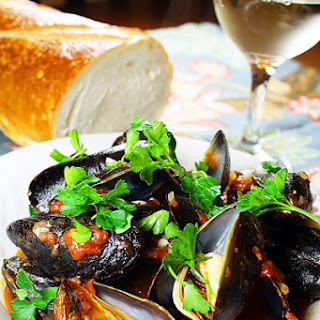 Steamed Mussels in White Wine and Tomato Sauce.