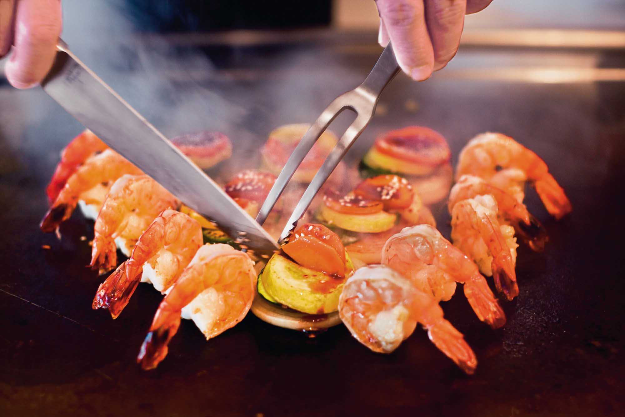 Twirling knives and juicy shrimp straight from the grill add up to a Hibachi style treat at Teppanyaki, an authentic Japanese experience on your Norwegian Cruise Line sailing.