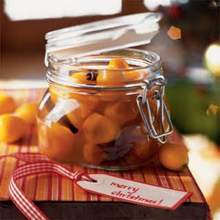 Kumquats in Spiced Syrup with Cloves, Cinnamon, and Star Anise.