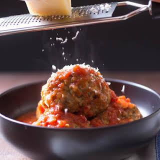 Juicy and Tender Italian-American Meatballs in Red Sauce.