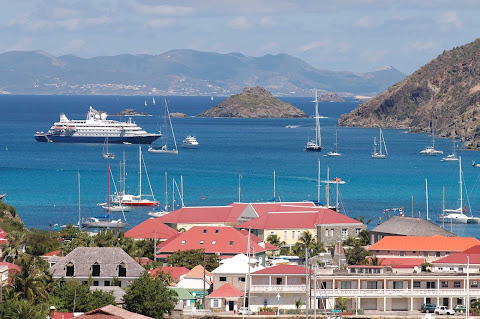 SeaDream II moored off Gustavia, the capital of scenic St. Barts. Take in sweeping vistas during a stay at Le Toiny.