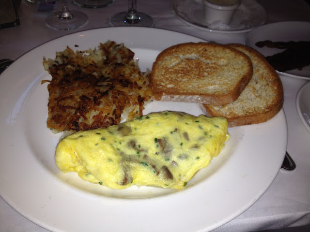 Mushroom & chive omelette with potatoes & gf toast. Can't begin to describe how amazing this was...