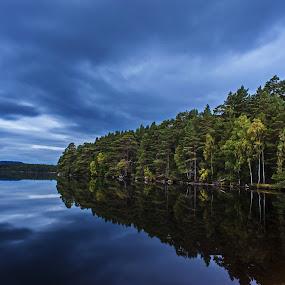 Blue hour by Jacek Steplewski - Landscapes Waterscapes ( clouds, scotland, water reflection, waterscape, blue hour, trees, reflections, forest, lake, landscape,  )