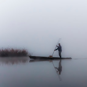 in the mist ... by Paulo Veiga - Landscapes Waterscapes ( canon, reflection, natural lake, wood, waterscape, ladscape, photography, portugal, pond, reflection onthe water, man, in the mist ..., water, work, 2014, grass, paulo veiga, pixoto, bateira, lake, boat, fog, herb, aveiro, eos 550d, pateira de fermentelos, fishing, sunrise, fisherman, early, mist,  )