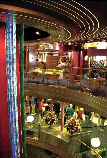 Holland-America-Volendam-Atrium - At the atrium of Holland America Line's Volendam is a monumental glass sculpture inspired by the myriad moods and colors of a kaleidoscope. It was created by Luciano Vistosi, one of Italy's leading contemporary glass artists.