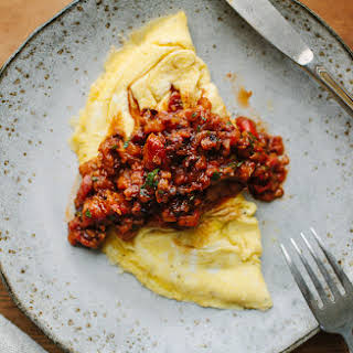 Two-Egg Omelet with Red Pepper–Walnut Spread.