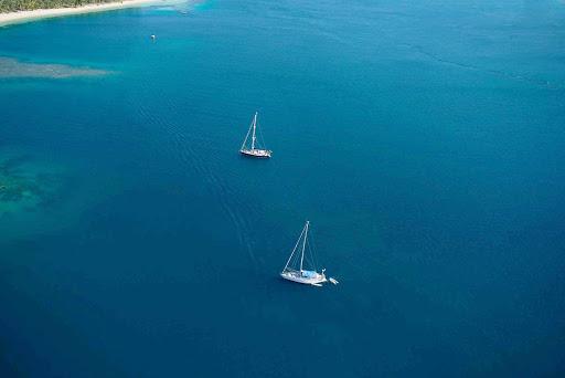 Fiji-lagoon-boating - Boating in an azure lagoon in Fiji.