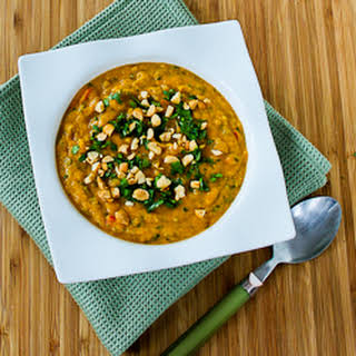 Slow Cooker Thai-Inspired Butternut Squash and Peanut Vegan Soup with Red Bell Pepper, Lime, and Cilantro.