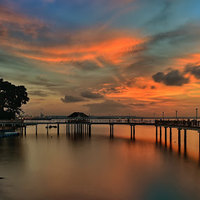 Sunset at Changi Boardwalk by Kristianus Setyawan - Landscapes Waterscapes ( wooden jetty, waterscape, sunset photography, seaside, seascape, jetty, landscape, boardwalk, singapore, changi boardwalk, sunset, landscape photography, skylines, skyview, sunset scenery, skyscape )