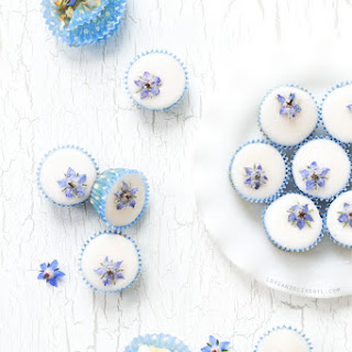 Almond Fairy Cakes with Candied Borage Flowers.