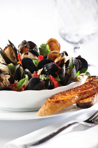 Norwegian-Cruise-Line-food-Ocean-Blue-mussels - Fresh mussels served at Ocean Blue, the specialty seafood restaurant that focuses on premium ingredients and expert culinary techniques. You'll find it on Norwegian Breakaway and Norwegian Getaway.