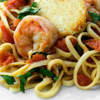 Shrimp, Tomato and Basil Linguine with Goat Cheese Rounds.