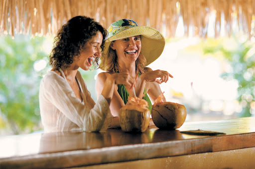 Let Paul Gauguin's staff fix you up with a cool beverage on their private islet, Motu Mahana.