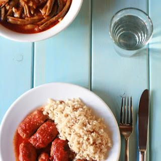 Soutzoukàkia - Cumin flavored meatballs in rich tomato sauce.