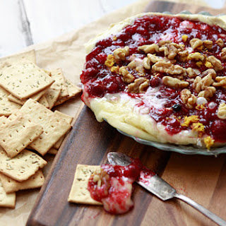 Baked Brie with Cranberry Sauce and Walnuts.