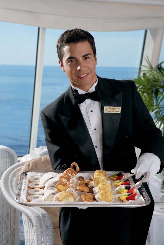 Teatime Waiters provide light treats on Crystal Serenity.