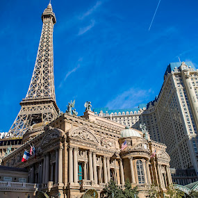 Eiffel Tower and Taxi by Clifford Swall - Buildings & Architecture Architectural Detail ( las vegas, eiffel tower, blue sky, las vegas strip )