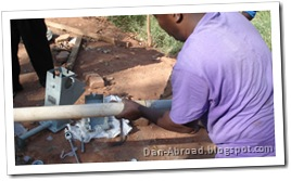 Afridev parts, cementing the cylinder with foot valve (grey piece) to the PVC pipe (white piece).