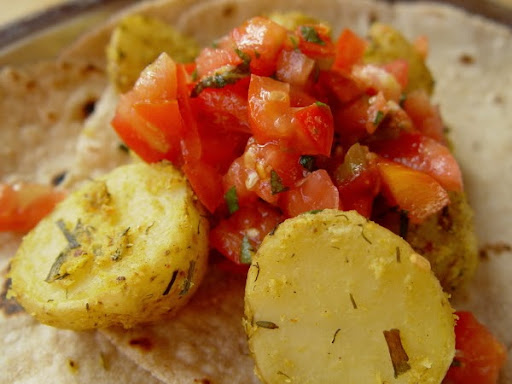 delicious baked potatoes with fresh tomato salad on chapati