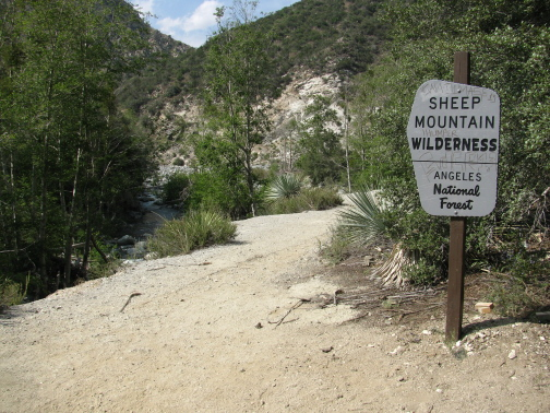 Sign stating that this is the Sheep Mountain Wilderness on the old road.