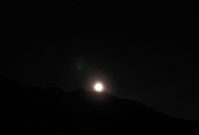 The moon rising above the local hills seen from Echo Mountain.