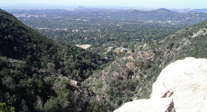 The view from on high out over the tiny canyon and into the sprawl of cities near Los Angeles.