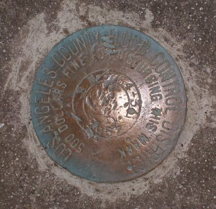 Survey marker on the footbridge.