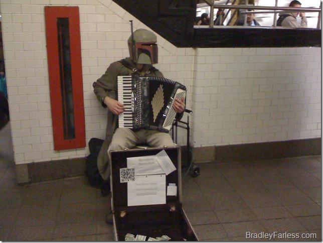 Boba Fett playing accordion on the L Train platform at Union Square.