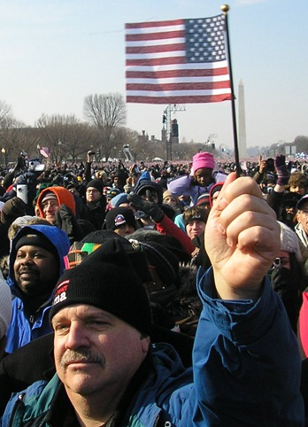 Man holding flag at Obama inauguration, 2009