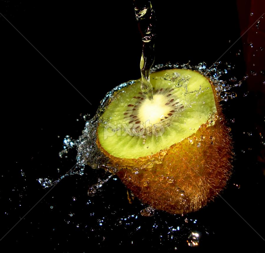 Kiwi Splashing by Premkumar Antony - Food & Drink Fruits & Vegetables ( water, stock, vitamins, diet, kiwi, food, fruits, health, cut kiwi, premkumar antony )