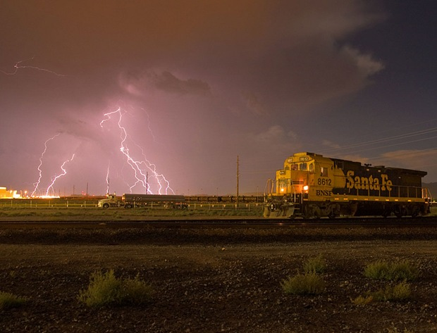 Thunderstorm seen while a rail engine passes through just east of the downtown Kingman area, in Arizona, USA