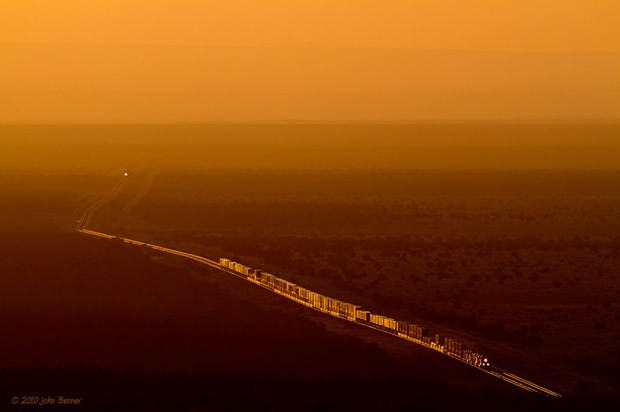 Sunrise on the Colorado Plateau greets a westbound train as it climbs the Arizona Divide with a manifest on it's block on the BNSF Seligman Subdivision.