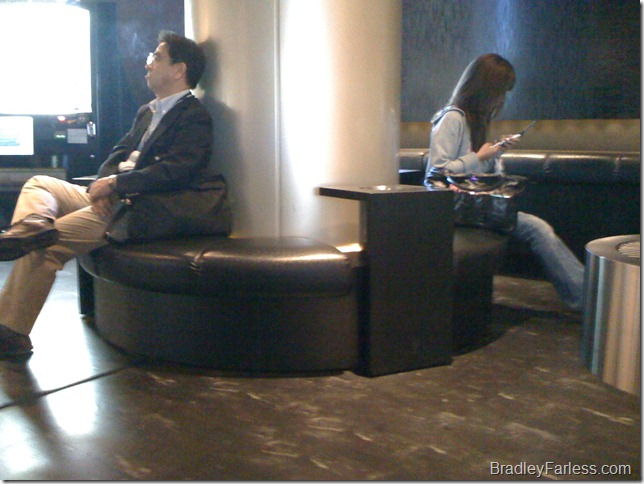 A Japanese man and woman taking a break in a smoking room at Narita Airport in Tokyo, Japan.