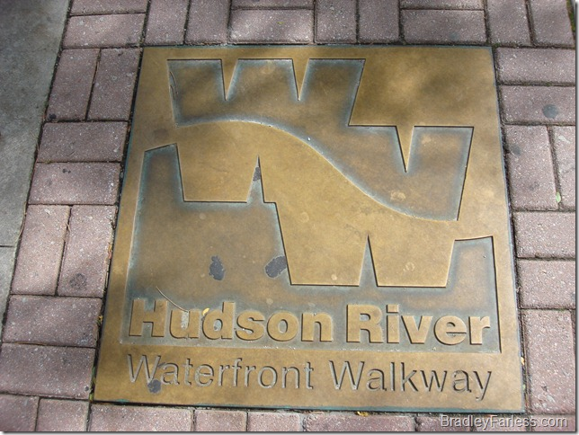 Hudson River Waterfront Walkway metal plaque set into the sidewalk.