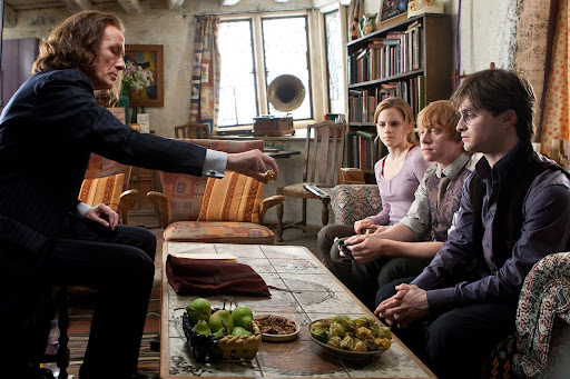 Rupert Grint as Ron Weasley, Bill Nighy as Rufus Scrimgeour, Daniel Radcliffe and Emma Watson as Hermione Granger in Harry Potter and the Deathly Hallows Part I