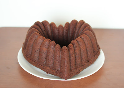 photo of a chocolate pound cake on a plate