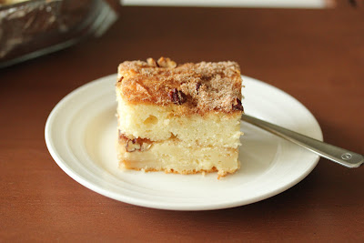 photo of a piece of coffee cake on a plate with a fork
