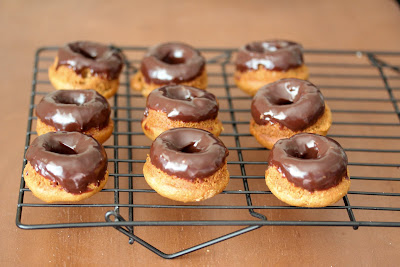 photo of mini cider donuts with chocolate ganache on a baking rack