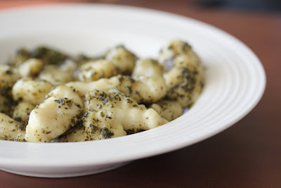 close-up photo of photo of a bowl of gnocchi tossed with pesto
