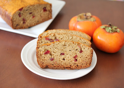photo of slices of Cranberry persimmon bread on a plate