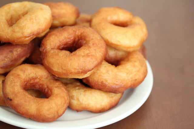 photo of plain fried donuts on a plate