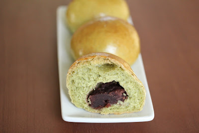 a close-up of a match bread roll sliced in half with the filling showing