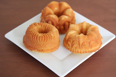 photo of three mini rum cakes on a plate
