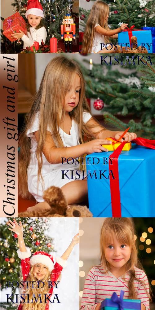 Stock Photo: Christmas gift and girl