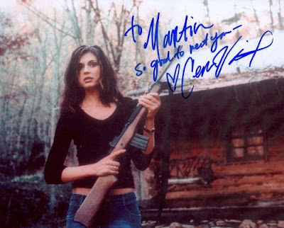 Cerina Vincent with a gun