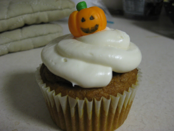 Pumpkin cupcake with a jack-o'-lantern on top