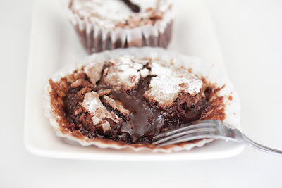 photo of a lava cake with chocolate oozing out