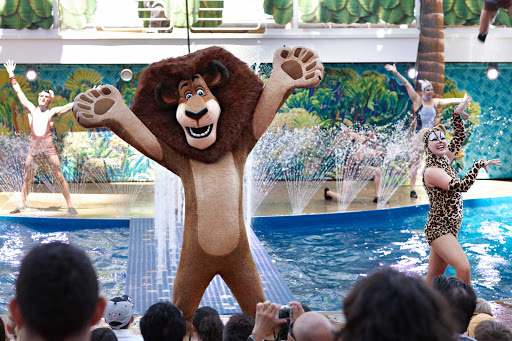 "Aqua-Theater-performance-Royal-Caribbean - Alex the Lion from the move ""Madagascar"" interacts with kids and audience members in the outdoor Aqua Theater aboard Oasis of the Seas."