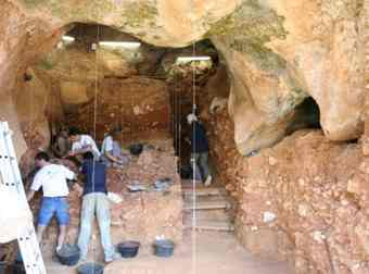 Archaelogists work on the dig in Sierra de Atapuerca where many bones from early humans have been found since the early 90s
